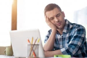 man tired during the day due to sleep apnea