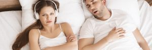 woman unhappy with snoring partner